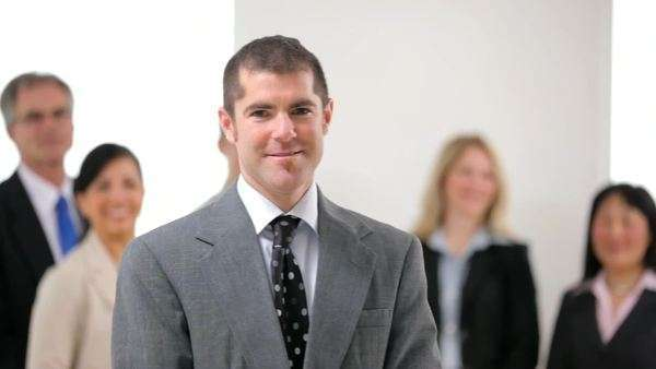 Portrait of business man with co-workers in background Royalty-free stock video