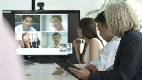 A meeting is conducted in a modern boardroom with the help of a tablet and a projection screen Royalty-free stock video
