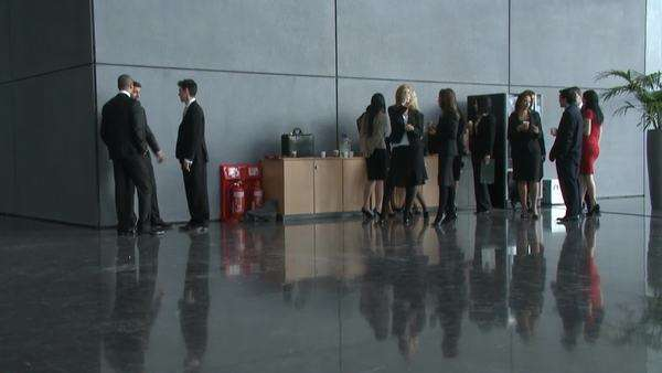 Business people at a presentation in an office atrium Royalty-free stock video