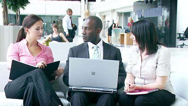 multiethnic young professionals in a meeting area of large office environment Royalty-free stock video