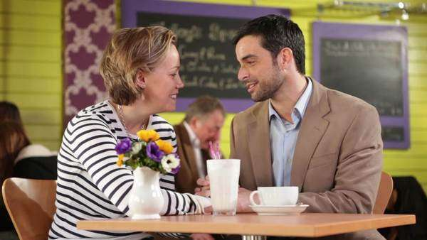 Relaxed man and woman in restaurant smiling Royalty-free stock video