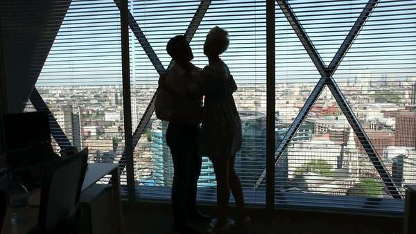 Business man and woman looking over city as they meet Royalty-free stock video