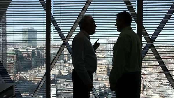 Businessman looking over city view from executive office Royalty-free stock video