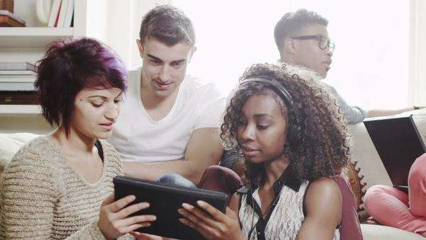 Young people relaxing and studying together Royalty-free stock video