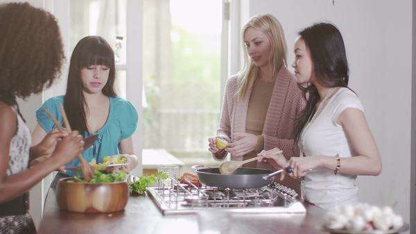 Young people in the kitchen prepare for a party Royalty-free stock video