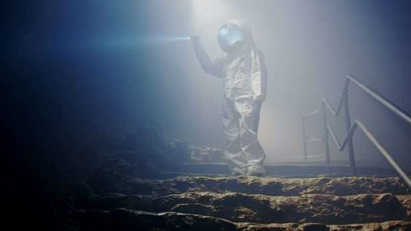 An Astronaut (or Alien) in dark cave structure Royalty-free stock video