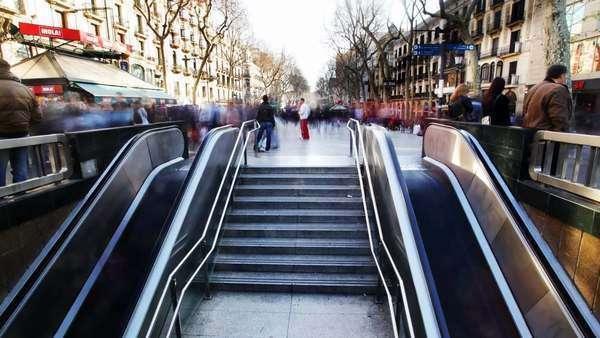 People going up and down subway entrance at Las Rambles, Barcelona Spain Royalty-free stock video
