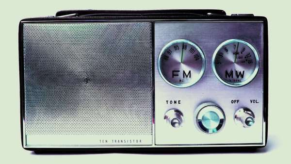 an old vintage portable FM and MW transistor radio with  the marker running through the different stations and frequencies Royalty-free stock video