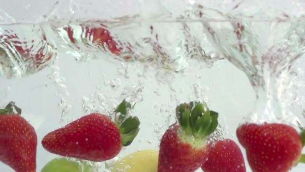 fresh fruit dropped into water shot in super slow motion with the Sony FS700 high speed camera Royalty-free stock video