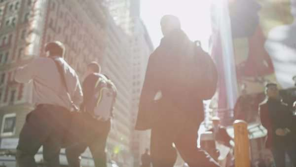 Crowds of people walking and traffic passing through a street in Manhattan on a bright sunny day. In slow motion. Royalty-free stock video