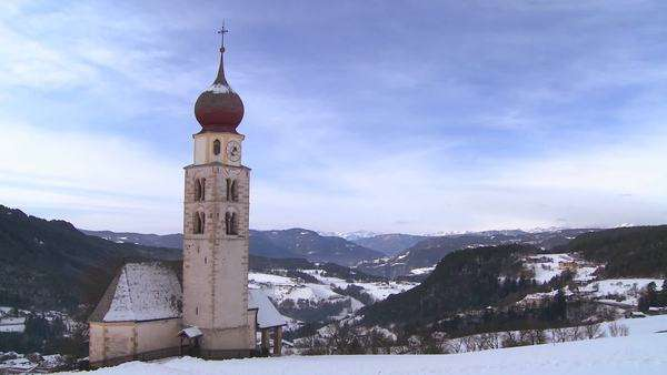 Timelapse clouds over an Eastern church in a snowbound Tyrolean village in the Alps in Austria, Switzerland, Italy, Slovenia or an Eastern European country. Royalty-free stock video