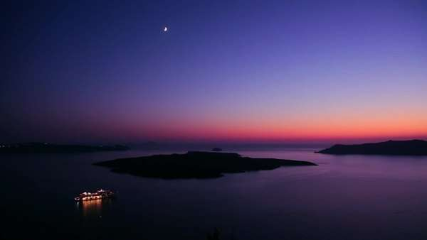 A cruise ship moves through the Greek Isles in purple light at dusk. Royalty-free stock video