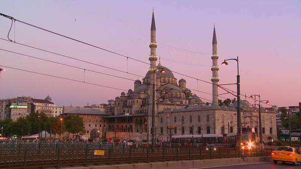 Rapid transit trams and traffic at dusk in front of a mosque in Istanbul, Turkey. Royalty-free stock video