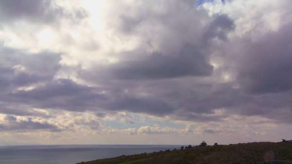 Storm clouds form over land and sea in this timelapse shot. Royalty-free stock video