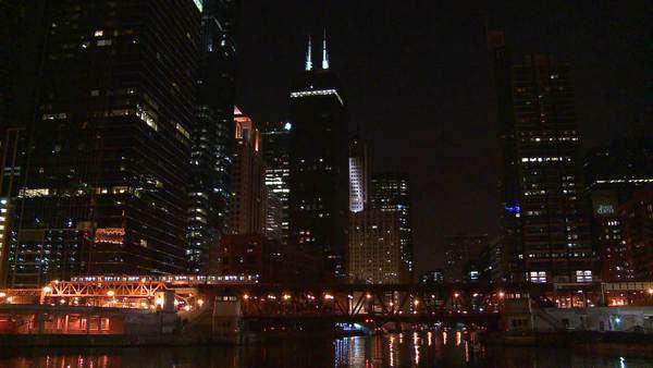 A beautiful nighttime shot as the El train crosses a bridge in front of the Chicago skyline. Royalty-free stock video