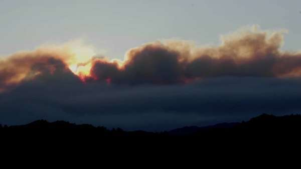 Close-up timelapse of a smoky sunset from wildfires in the Santa Ynez Mountains, California. Royalty-free stock video