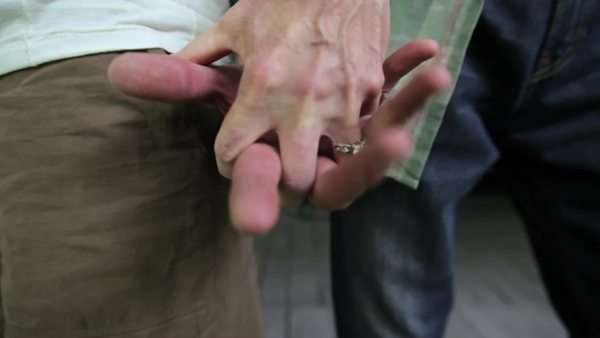 Mature couple holding hands, close-up Royalty-free stock video