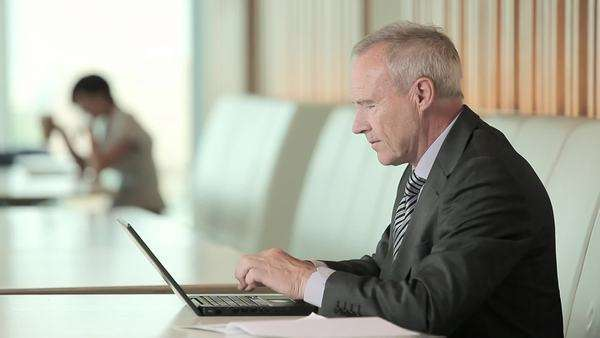 Businessman using laptop and looking at camera Royalty-free stock video