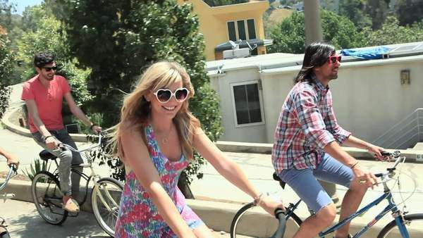 Friends riding bicycles on vacation Royalty-free stock video