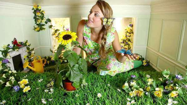 Young woman with garden in small room Royalty-free stock video