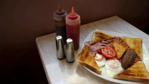 English breakfast on a cafe table Royalty-free stock video
