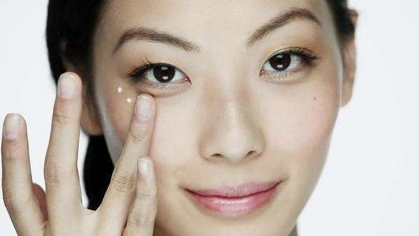 Young woman applying eye cream Royalty-free stock video
