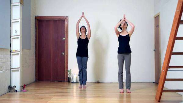Two women practicing yoga Royalty-free stock video