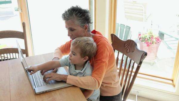 Grandmother and grandson using laptop Royalty-free stock video