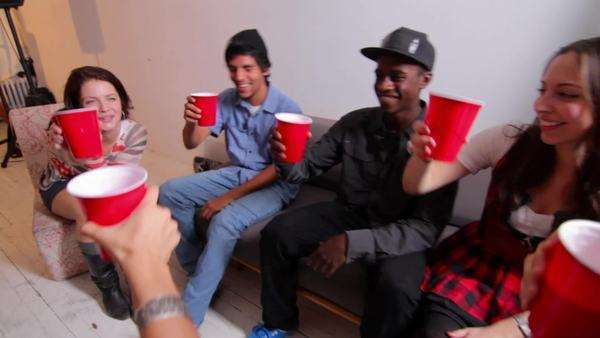 Group of young people drinking alcohol at party Royalty-free stock video