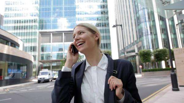 Businesswoman speaking on cellphone in city Royalty-free stock video