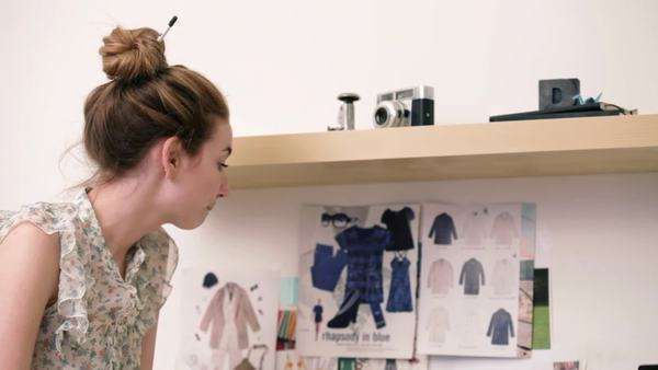 Young female fashion designer looking at color swatches Royalty-free stock video