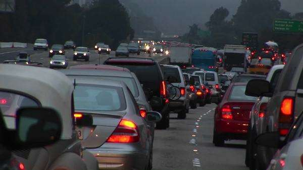 Traffic drives slowly on a crowded highway. Royalty-free stock video