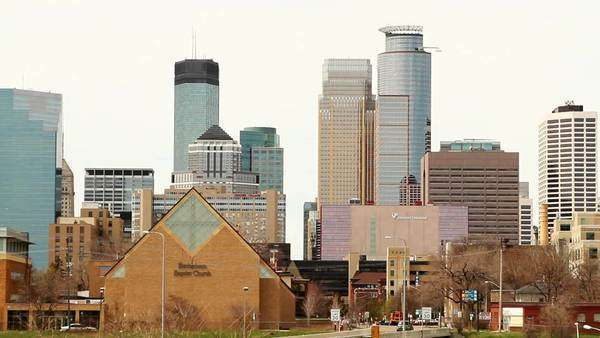 Skyline of downtown Minneapolis-St. Paul with church in foreground Royalty-free stock video