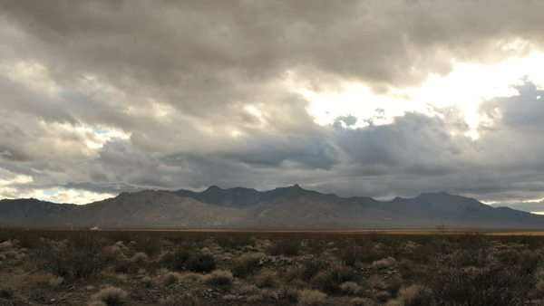 Timelapse of storm clouds passing over the mountain and desert Royalty-free stock video