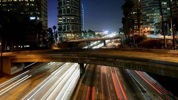 Busy Harbor Freeway in at night, downtown Los Angeles Royalty-free stock video