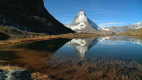 Matterhorn reflected in clear alpine lake, Switzerland Royalty-free stock video