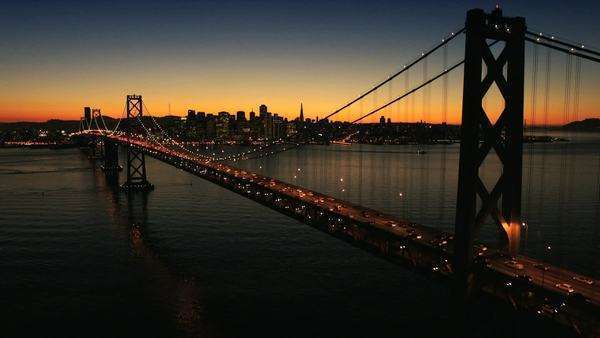Aerial sunset view of the Oakland Bay Bridge at night with the illuminated light from traffic, San Francisco, North America Royalty-free stock video
