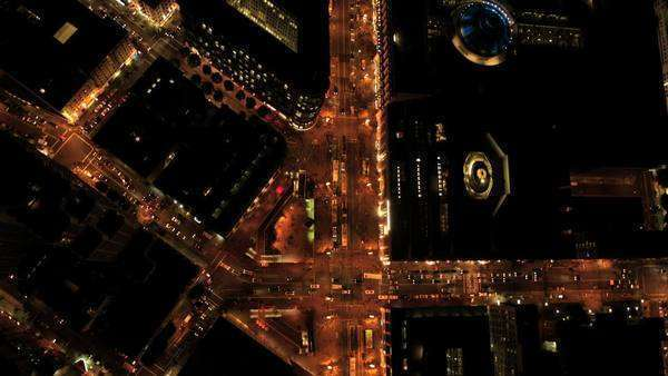 Aerial night vertical view of San Francisco city street traffic and illuminated skyscrapers, North America, USA Royalty-free stock video