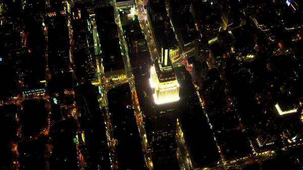 Aerial overhead view Empire State Building, avenues of roads all illuminated at night, Manhattan, New York, America, shot on RED EPIC Royalty-free stock video