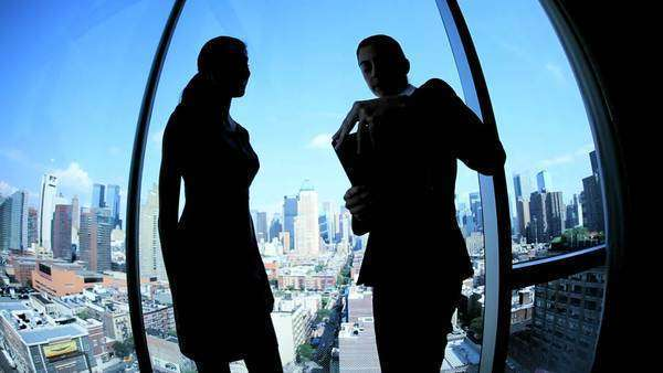 Silhouette multi ethnic female executive managers starting meeting handshake working on tablet computer in Manhattan Royalty-free stock video