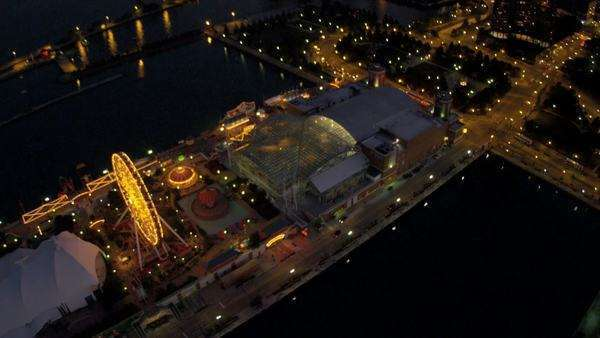 Aerial vertical illuminated view Navy Pier, Amusement Park, Ferris Wheel, Navy Park, Chicago, Illinois, USA, shot on RED EPIC Royalty-free stock video