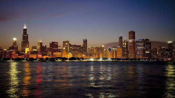 Timelapse illuminated city skyline view Sears Tower, downtown Chicago at dusk Lake Michigan, Illinois, USA Royalty-free stock video