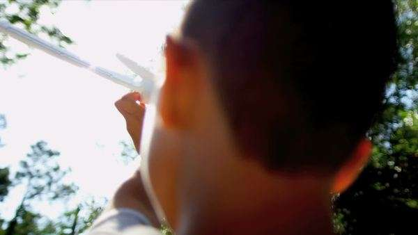 Young boy playing outdoors alone with homemade airplane shot on RED EPIC Royalty-free stock video