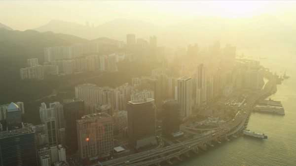 Aerial sunset view of Hong Kong and Kowloon over Victoria Harbour, China, Asia, RED EPIC Royalty-free stock video