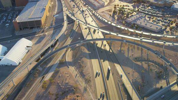 Aerial view of the suburban Freeway traffic Intersection commercial business area Las Vegas sun lens flare Nevada, USA, RED EPIC Royalty-free stock video