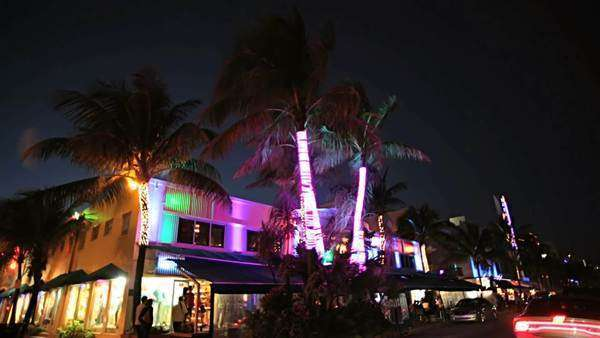 Night P.O.V. driving by illuminated restaurants on Ocean Drive Miami, USA Royalty-free stock video