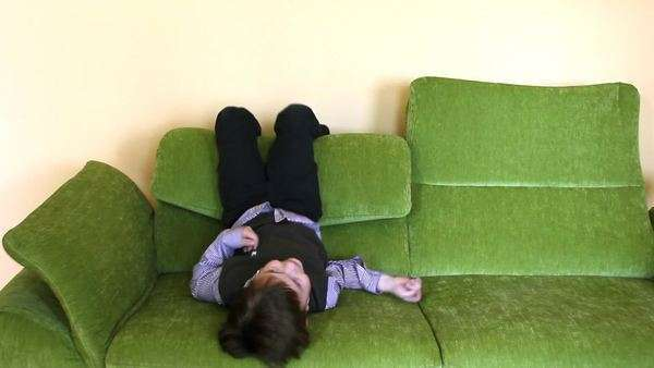 Boy upside down on a couch Royalty-free stock video