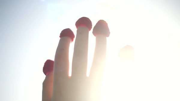 Five fingers with raspberries stuck on fingertips against blue sky Royalty-free stock video