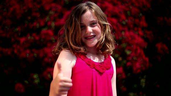 Redheaded girl giving thumbs up outdoors Royalty-free stock video