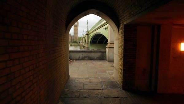 A shot of an archway in a tunnel underneath the bridge that shows Big Ben in London, England on October 9, 2011. Royalty-free stock video